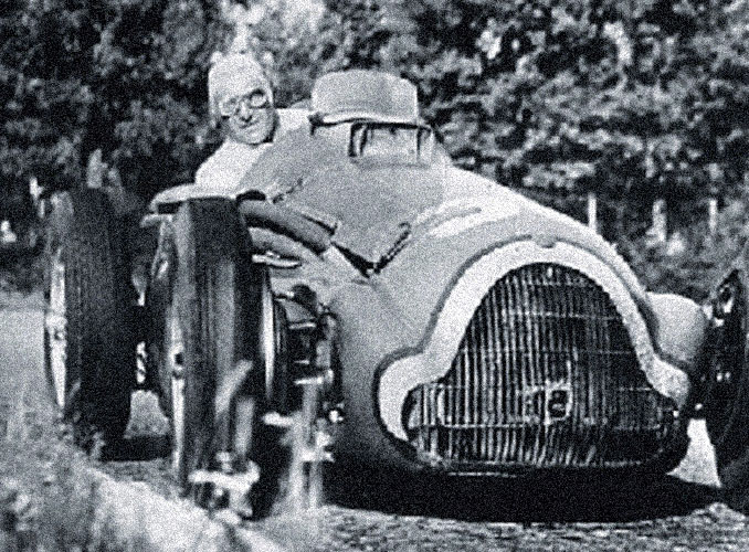 <p>Baron Philippe, a keen racing driver, at the wheel of his Bugatti during a Grand Prix.</p>