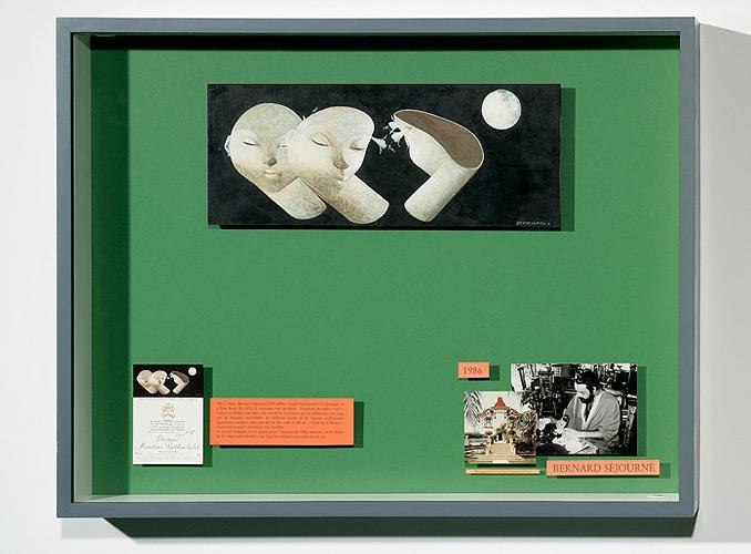 """<p><strong>1986 Bernard Séjourné</strong></p> <p>Surgissant de la profondeur de la nuit dans sa """"négritude blanche"""", son trio de masques pour l'étiquette de Mouton Rothschild 1986 est un des exemples les plus achevés de son talent.</p>"""