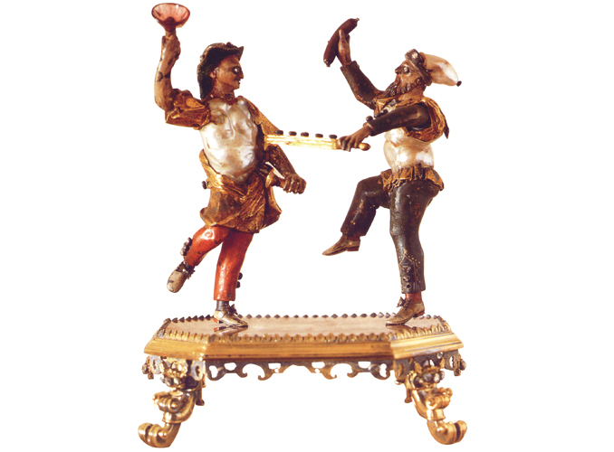 <p><b>Two C<i>ommedia dell'Arte</i> characters</b></p> <p>Circle of Johann Melchior Dinglinger<br /> Silver-gilt and silver decorated with enamel, pearls, chalcedony and diamond</p> <p>Height 11.5 cm<br /> Probably Germanic countries – Early 18<sup>th</sup> century</p>